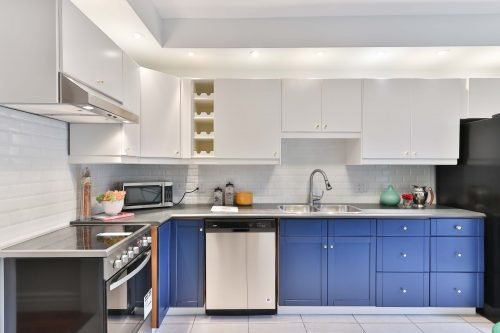 a modern kitchen with blue and white units