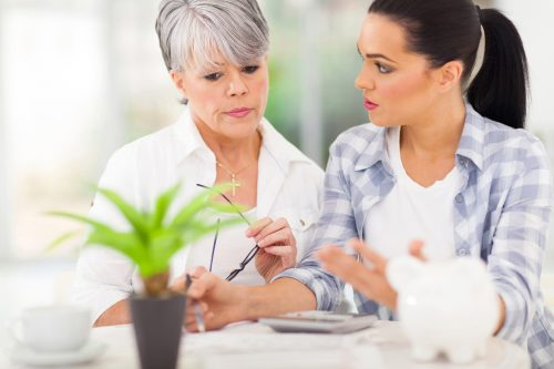 mother helping daughter with her finances