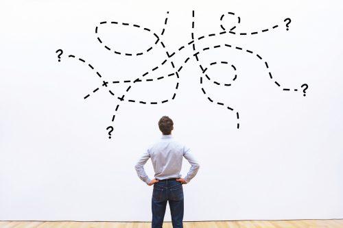 Man looking at virtual paths on wall