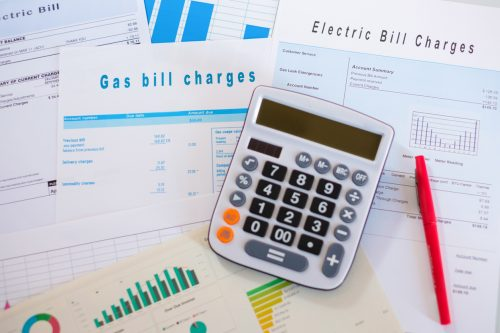 paperwork for energy bills and a calculator