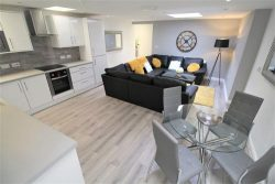 living room and kitchen area of a 4 bedroom apartment in wavertree