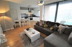 living, dining and kitchen area of a 2 bedroom apartment in the baltic triangle area of liverpool